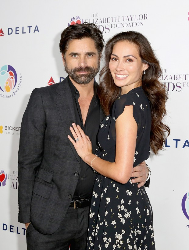 BEVERLY HILLS, CA - OCTOBER 24:  (EDITORIAL USE ONLY. NO COMMERCIAL USE)  John Stamos (L) and Caitlin McHugh attend The Elizabeth Taylor AIDS Foundation and mothers2mothers dinner at Ron Burkle's Green Acres Estate on October 24, 2017 in Beverly Hills, California.  (Photo by Rachel Murray/Getty Images for mothers2mothers and The Elizabeth Taylor AIDS Foundation ) mothers2mothers And The Elizabeth Taylor AIDS Foundation Benefit Dinner At Ron Burkle's Green Acres Estate 2017 Getty Images 775051810 98142498 Getty Images North America Stringer